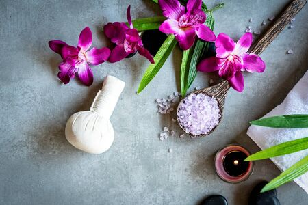 Thai Spa. Top view of hot stones setting for massage treatment and relax with purple orchid on blackboard with copy space.  Lifestyle Healthy Concept Stock Photo