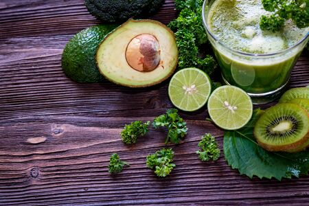 Healthy Juice. Green smoothie, Organic and Fresh green vegetable for detox and vegan, diet and weight loss on the wood background, top view and copy space. Healthy Concept