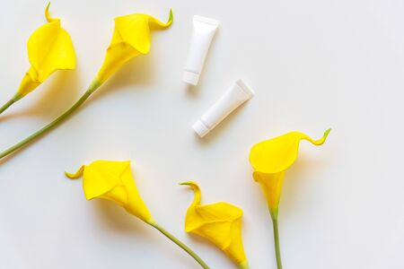 Spa cosmetic and lotion products organic concept, spa beautiful massage with yellow flower on white background top view and copy space for text, Thai Spa relax and treatment for body healthy.