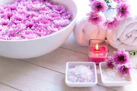 Aromatherapy Spa with candle and pink flower spa and rolled towel. Thai Spa relax Treatments and massage white background, select focus.  Healthy Concept.