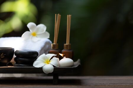 Thai spa composition treatments aromatherapy with candles and Plumeria flowers. Healthy and Relax Concept Stock Photo - 133884170