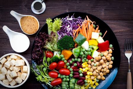 Fresh vegetable salad and healthy food for women diet slimming with  medical stethoscope.  Healthy people for weight loss on wood background. Healthy Sport Concept