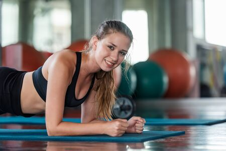 Lifestyle women functional training exercise  and cross fit the gym workout for healthy care and bodybuilding.  Fitness instructor exercising the fitness. Healthy sport Concept Stock Photo