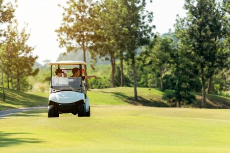 Group Professional Golfer asian man and friend sitting on the car golf go to golf course shot continue game. Hobby in holiday and vacations in sunny morning day on club golf. Lifestyle and Sport Concept