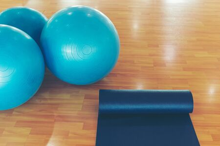 Yoga ball and map yoga in fitness room. Healthy Concept