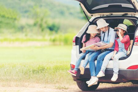 Group family children travel on car for adventure nature in vacations. Asia people tourism checking map for explore natural destination and leisure trips travel for education. Travel Concept