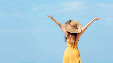Summer Vacation. Lifestyle woman raise arm and hand on wave relax and happy on beach tropical outdoor in summer day. Young people luxury and destination in holiday. Tourism chill leisure of trips. Stock Photo