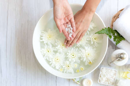 Spa beauty massage health wellness.  Spa Thai therapy treatment aromatherapy for nail and hands woman with white flower nature candle for relax and summer time. Lifestyle and cosmetic Concept