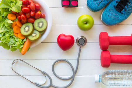 Health Care.  Fresh vegetable salad and green apple with medical stethoscope for diet and weight loss for healthy care and protect virus,  white wooden background.  Copy space and banner for text.  Healthy Life ConceptHealth Care.  Fresh vegetable salad and green apple with medical stethoscope for diet and weight loss for healthy care and protect virus,  white wooden background.  Copy space and banner for text.  Healthy Life Concept Stock Photo