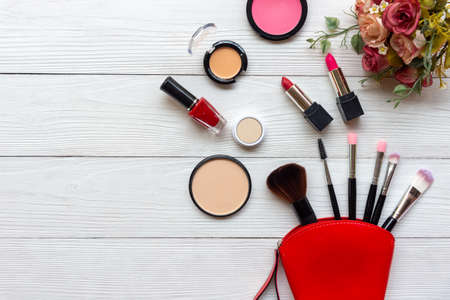 Makeup beauty cosmetic fashion set background. Cosmetics woman bag product facial, lipstick, rose flower and items decorative composition flat lay on white background. Lifestyle fashion Valentine Gift Concept Stock Photo