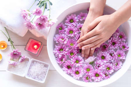 Spa beauty massage health wellness.  Spa Thai therapy treatment aromatherapy for nail and hands woman with pink flower nature candle for relax and summer time. Lifestyle and cosmetic Concept Stok Fotoğraf