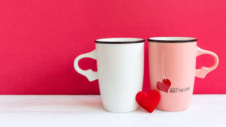 Valentine's Day with two cup coffee red heart on the cup, wood white background, copy space  and banner for text. Valentine Concept.