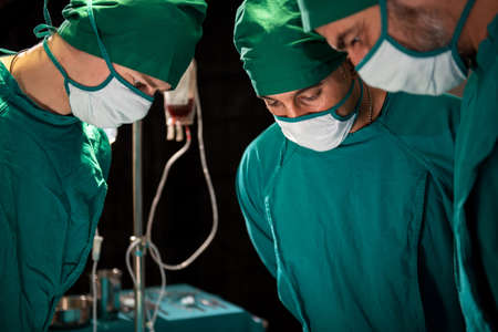 Group and teamwork of surgeons in hospital operating theater. Teamwork medical doctor working  performing surgery