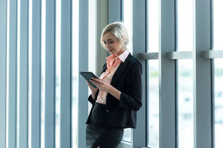 Business women using tablet computer to work with financial data in the modern office, relax and rest time after work.  Business Concept.