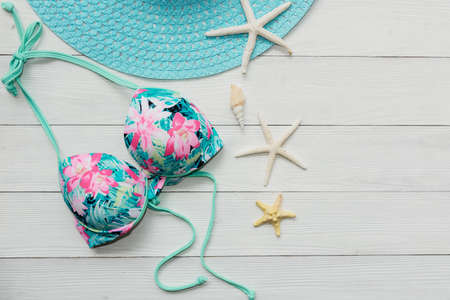 Summer items and accessories  traveler woman colorful bikini , camera go to travel plan holiday vacation in the beach. Tropical sea. Unusual top view, Travel and Summertime Concept. Banco de Imagens