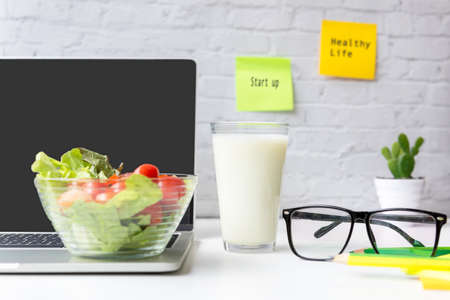 Healthy snack with working in the office.  Green apple and fresh salad with milk for diet Health life