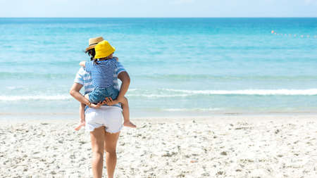 Asia happy family have fun and running relax on the beach for leisure and destination.  Family people tourism travel enjoy in summer and holiday.  Travel and Family Concept, Copy space for banner