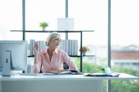 Relax time.  Successful Businesswoman relaxing  after sitting and hard working in modern office. Young people working and connection business online.  Healthy care for time. Business Concept Фото со стока