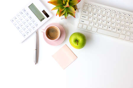 Healthy snack with working in the office.  Green apple pink cup black coffee for diet Health life with laptop on white dress working, write take care white background.  Healthy Lifestyle Concept
