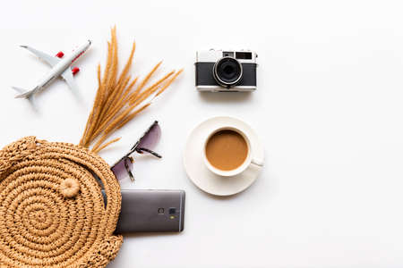 Traveler accessories and items  women tourism backpack and visiting for planning trips travel destination and vacations.  Cup coffee drink with planning tour in holiday.   copy space.  Vintage tone.  Travel and Summer holiday concept Фото со стока
