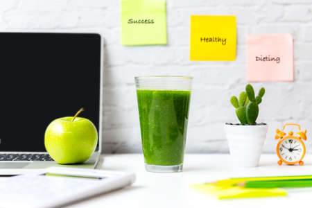 Healthy snack with working in office.  Green apple and vegetable smoothie for diet Health with laptop on white dress working.  Healthy Lifestyle Concept Фото со стока
