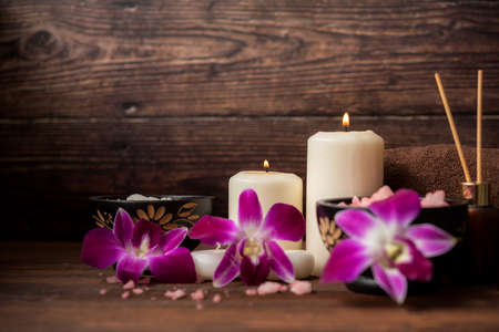 select focus. Thai Spa Treatments aroma therapy salt and nature sugar scrub massage with orchid flower with candle. Thailand. Healthy Concept. Фото со стока