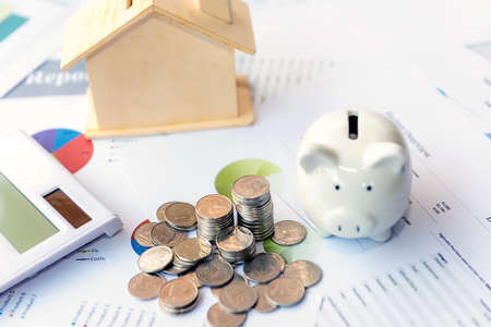 Piggy bank saving and investment with statistics accounting info which including of many economic statistics business. Report finance background.  Investment Concept