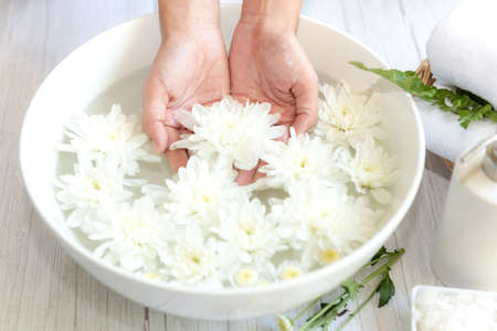 Spa treatment and massage product for female manicure nails skin care with white flower.  Woman happy and relax with spa massage Thai. Healthy and Beauty  Concept.