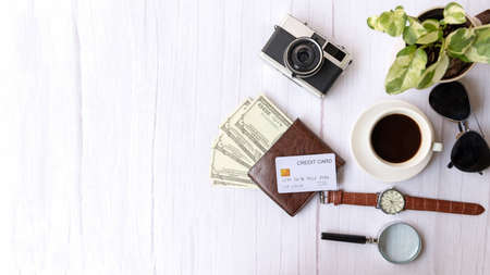 Top view of Traveler item accessories and credit card with tourism backpack and visiting for planning trips travel destination and vacations on white world, copy space.  Travel and Summer holiday concept