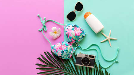 Summer items and accessories  traveler woman colorful bikini , camera go to travel plan holiday vacation in the beach. Tropical sea. Unusual top view, Travel and Summertime Concept. Foto de archivo