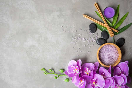 Thai Spa Treatments aroma therapy salt and sugar scrub massage with purple orchid flower on backboard with candle. Thailand. Healthy Concept
