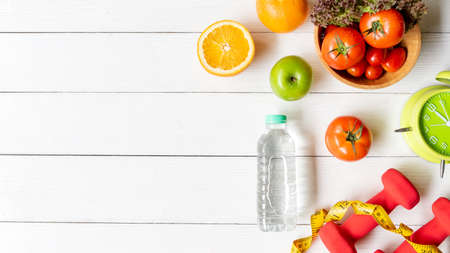 Diet Health eat and food for lifestyle health concept. Sport exercise equipment workout with fresh fruit and measuring tap for fitness style. Nutrition Healthy Lifestyle Concept, Top view and copy space
