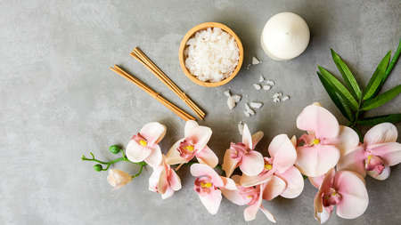 MassageThai Spa.  Spa massage setting for treatment and relax with  pink orchid on blackboard.  Lifestyle Healthy Concept,  copy space for banner, top view