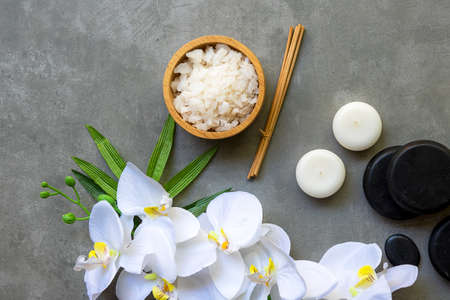 Thai Spa.  Massage spa and hot stones setting for treatment and relax with white orchid on blackboard.  Lifestyle Healthy Concept,  copy space for banner, top view