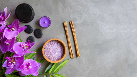 select focus. Thai Spa Treatments aroma therapy salt and sugar scrub massage with purple orchid flower on backboard with candle. Thailand. Healthy Concept.