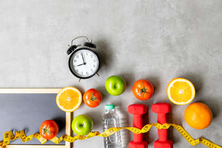 Diet Health eat and food for lifestyle health concept. Sport exercise workout and fresh fruit and measuring tape with backboard for fitness style. Nutrition Healthy Lifestyle Concept, Top view and copy space Foto de archivo