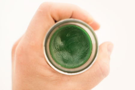 cream and green: Balm jars from joint pain in hand, medicine Stock Photo