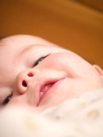 Cute young  baby boy smiling  happily photo
