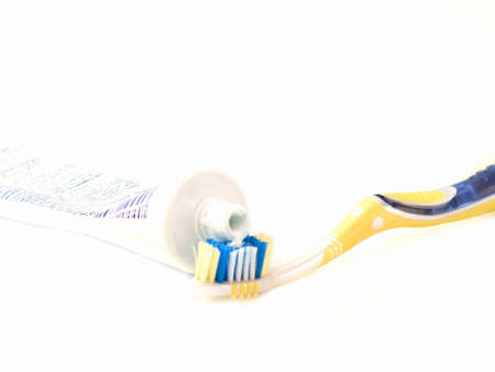 Modern tooth brush and tooth paste isolated on white photo