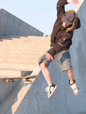 Airborne - young male skateboarder falling off his board Stock Photo - 4788031