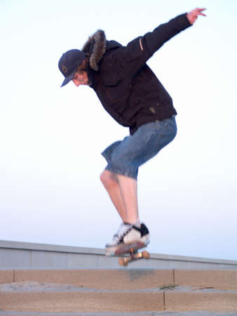 Awesome - Modern Teen doing a stunt on skate board in the city Stock Photo - 4788039