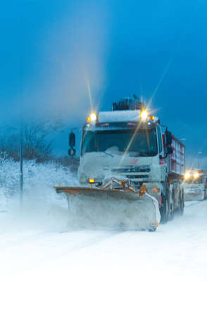 Winter safety - Trucks clearing the snow with their snow plows photo