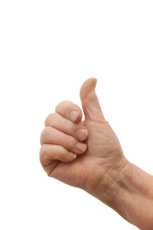 Good job - Old females hand giving thumbs up on white background photo