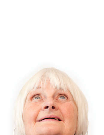 Older woman looking up at copyspace on white background photo