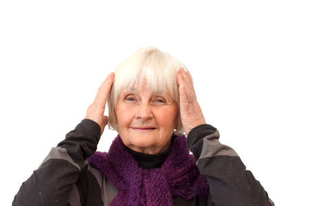 Monkey hear no evil - Older woman on white with hands over ears Stock Photo - 6302888
