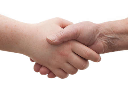 Diversity - young and old  shaking hands together photo