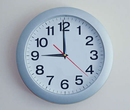 twenty second: Isolated electronic waal clock with black arrows