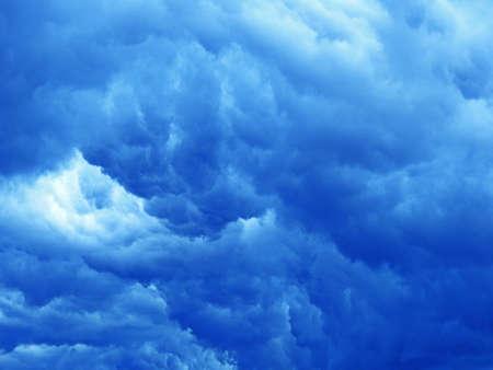rudeness: Massive dark blue clouds on sky before storm.