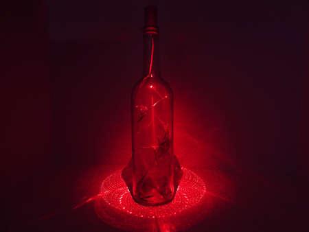 laser lights: Glass bottle in abstraction with laser lights.