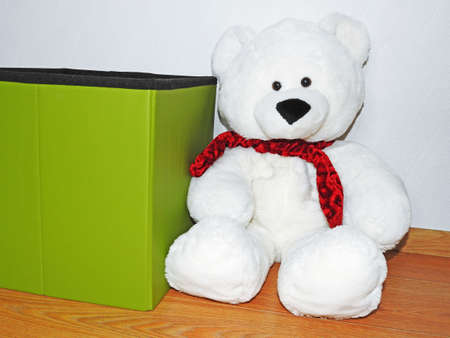 White big sitting Teddy bear with red scarf Stock Photo